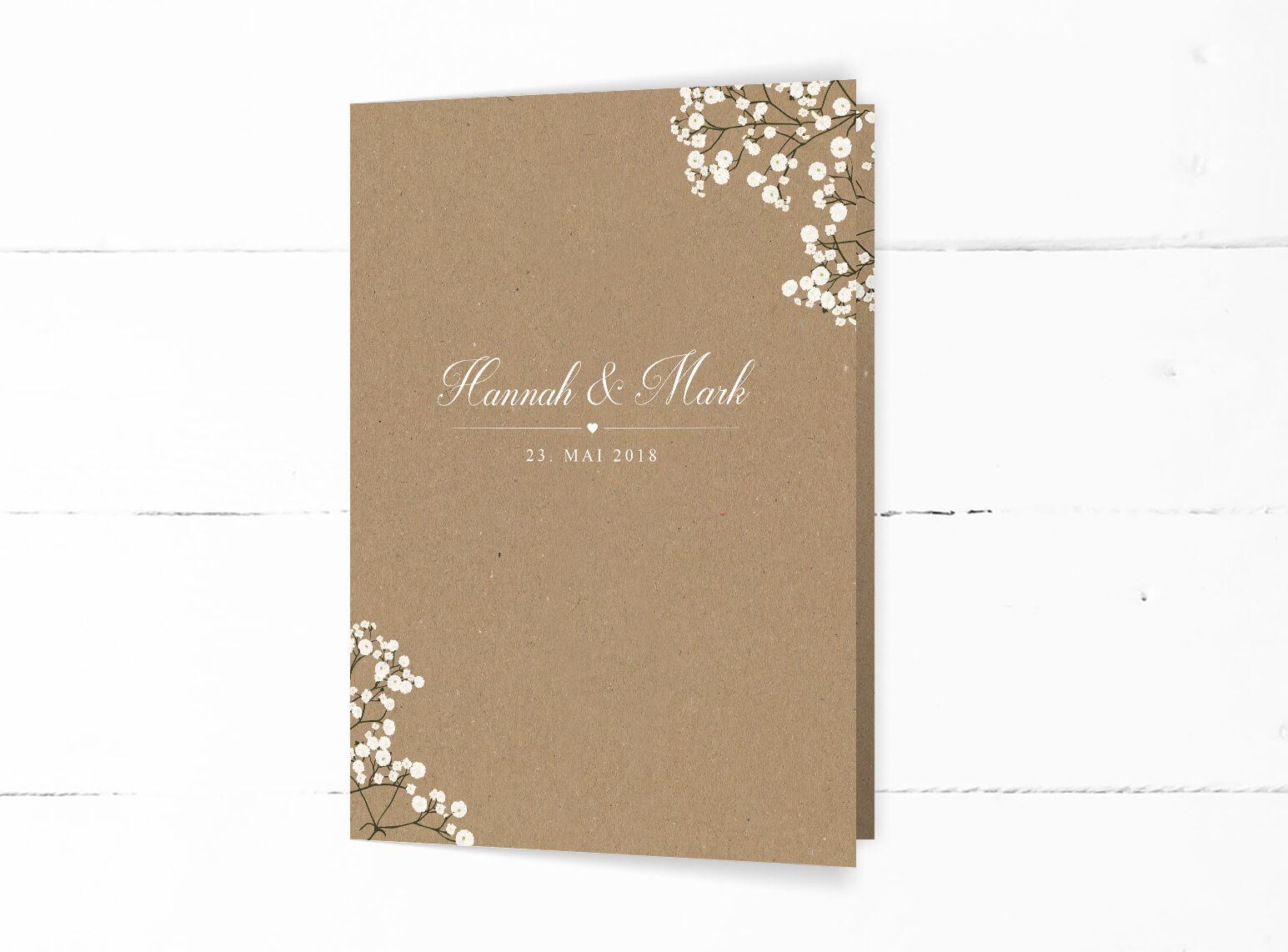 Hochzeitseinladung Kraftpapier weiße Blumen